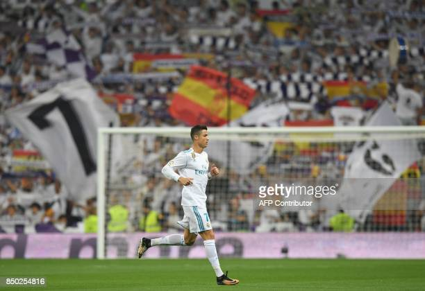 Real Madrid's forward from Portugal Cristiano Ronaldo runs during the Spanish league football match Real Madrid CF against Real Betis at the Santiago...