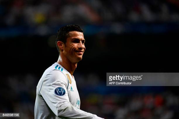 Real Madrid's forward from Portugal Cristiano Ronaldo smiles during the UEFA Champions League football match Real Madrid CF vs APOEL FC at the...