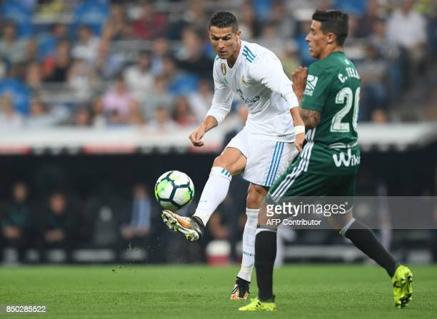 Real Madrid's forward from Portugal Cristiano Ronaldo vies with Real Betis' forward from Spain Tello during the Spanish league football match Real...