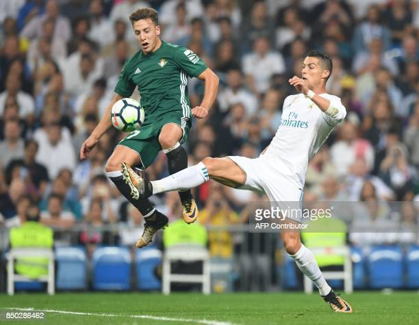 Real Madrid's forward from Portugal Cristiano Ronaldo vies with Real Betis' forward from Spain Francis Guerrero during the Spanish league football...