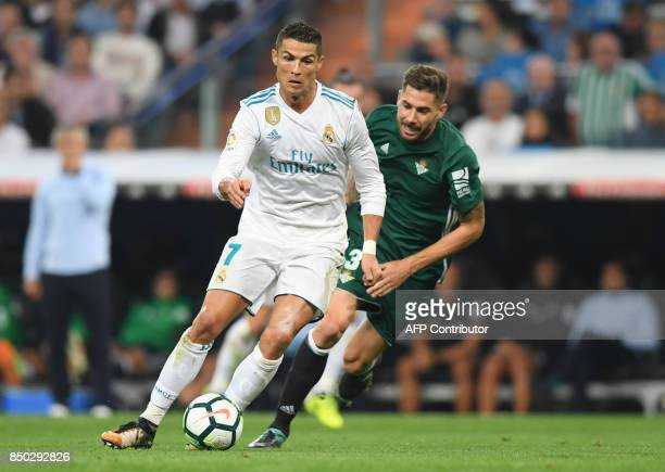 Real Madrid's forward from Portugal Cristiano Ronaldo vies with Real Betis' midfielder from Spain Javi Garcia during the Spanish league football...