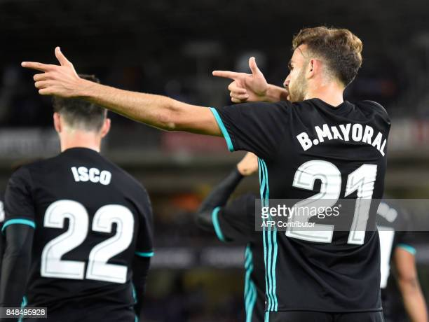 Real Madrid's forward from Spain Borja Mayoral celebrates after scoring his team's first goal during the Spanish league football match Real Sociedad...