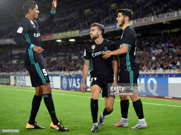 Real Madrid's forward from Spain Borja Mayoral is congratulated by teammates Real Madrid's defender from France Raphael Varane and Real Madrid's...
