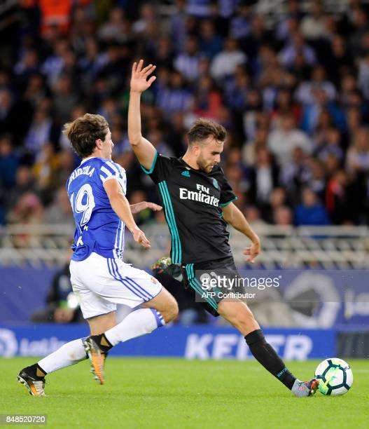 Real Madrid's forward from Spain Borja Mayoral vies with Real Sociedad's defender from Spain Alvaro Odriozola during the Spanish league football...