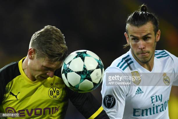 Real Madrid's forward from Wales Gareth Bale and Dortmund's German forward Maximilian Philipp vie for the ball during the UEFA Champions League Group...