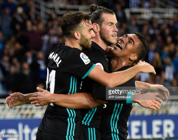 Real Madrid's forward from Wales Gareth Bale celebrates his team's third goal with Real Madrid's midfielder from Brazil Casemiro and Real Madrid's...