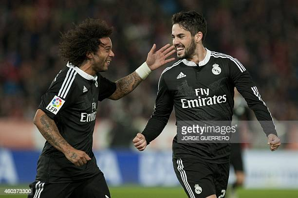 Real Madrid's forward Isco celebrates with Brazilian defender Marcelo after scoring during the Spanish league football match UD Almeria vs Real...