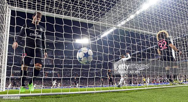 Real Madrid's forward Jese Rodriguez celebrates the goal of Real Madrid's defender Nacho Fernandez next to Paris SaintGermain's Brazilian defender...