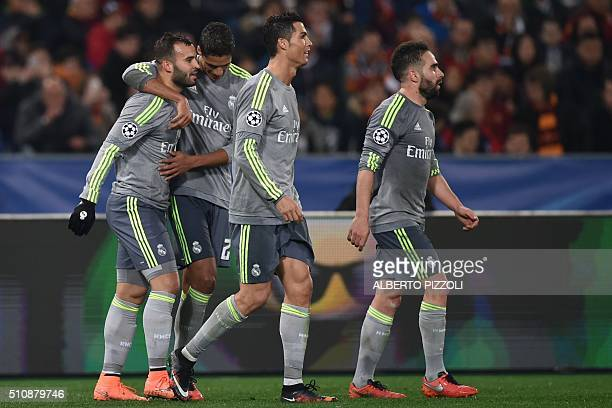 Real Madrid's forward Jese Rodriguez celebrates with teammates Real Madrid's Portuguese forward Cristiano Ronaldo Real Madrid's French defender...