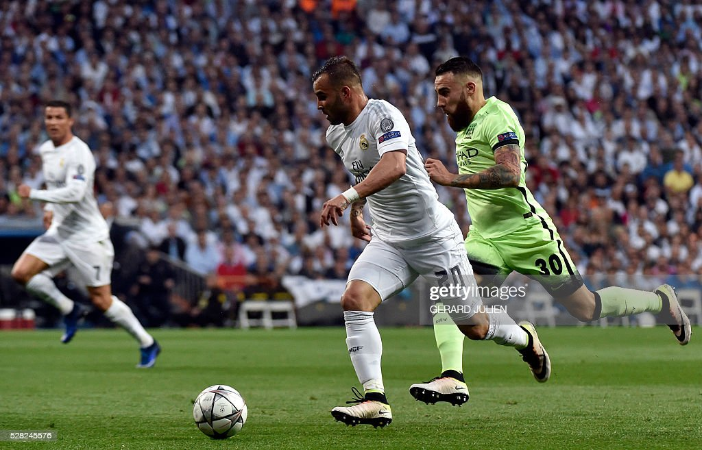 Real Madrid's forward Jese Rodriguez (L) vies with Manchester City's Argentinian defender Nicolas Otamendi (R) during the UEFA Champions League semi-final second leg football match Real Madrid CF vs Manchester City FC at the Santiago Bernabeu stadium in Madrid, on May 4, 2016. / AFP / GERARD