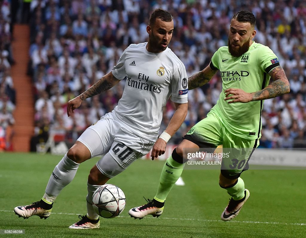 Real Madrid's forward Jese Rodriguez (L) vies with Manchester City's Argentinian defender Nicolas Otamendi during the UEFA Champions League semi-final second leg football match Real Madrid CF vs Manchester City FC at the Santiago Bernabeu stadium in Madrid, on May 4, 2016. / AFP / GERARD