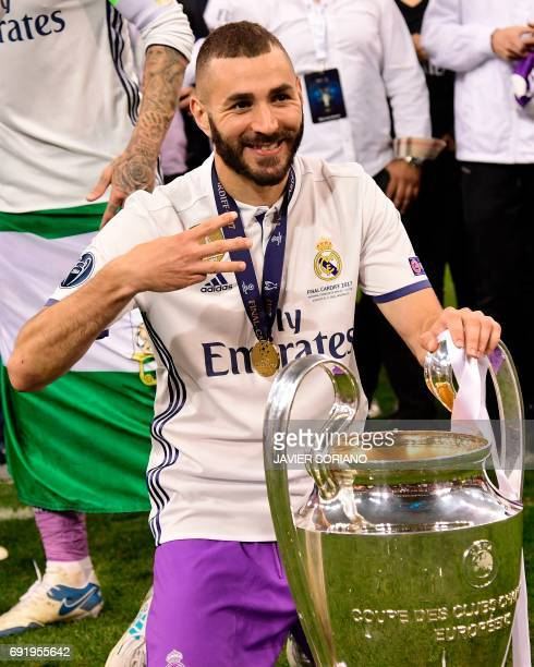 Real Madrid's forward Karim Benzema poses with the trophy after Real Madrid won the UEFA Champions League final football match between Juventus and...