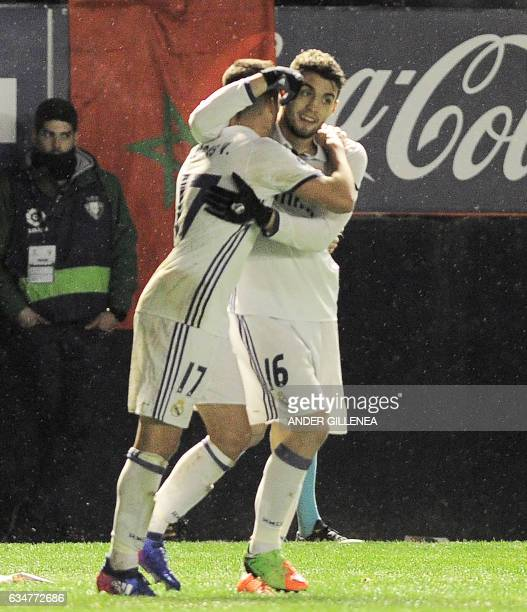 Real Madrid's forward Lucas Vazquez is congratulated by teammate Croatian midfielder Mateo Kovacic after scoring his team's third goal during the...