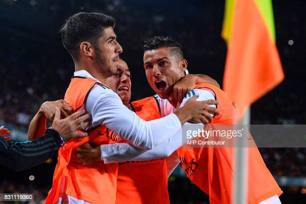 Real Madrid's forward Marco Asensio Real Madrid's forward Lucas Vazquez and Real Madrid's Portuguese forward Cristiano Ronaldo celebrate Barcelona's...