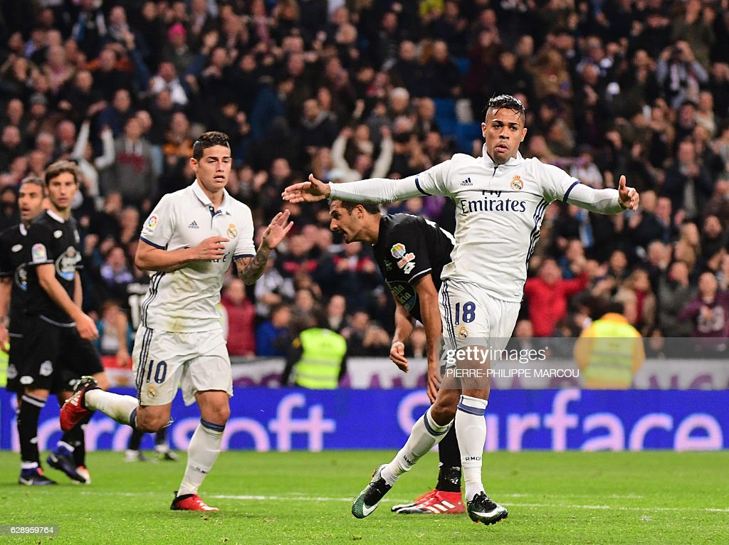 Real Madrid's forward Mariano Diaz (R) celebrates after scoring during the Spanish league football match Real Madrid CF vs RC Deportivo at the Santiago Bernabeu stadium in Madrid on December 10, 2016. / AFP / PIERRE