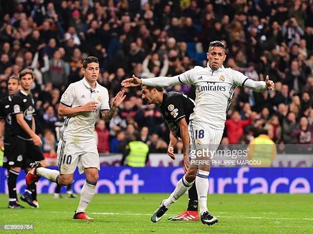 Real Madrid's forward Mariano Diaz celebrates after scoring during the Spanish league football match Real Madrid CF vs RC Deportivo at the Santiago...