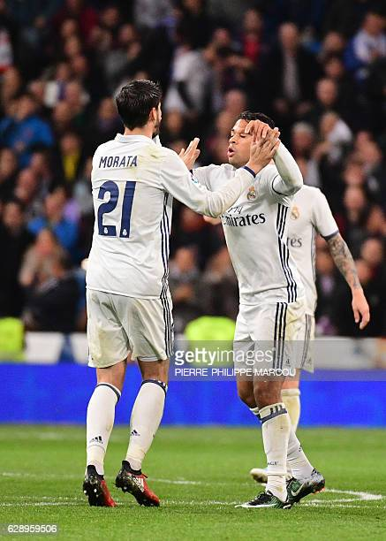 Real Madrid's forward Mariano Diaz celebrates after scoring with Real Madrid's forward Alvaro Morata during the Spanish league football match Real...