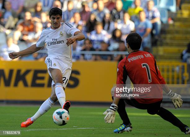 Real Madrid's forward Morata kicks the ball to score past Deportivo's Argentinian goalkeeper German Lux during the Trophy Teresa Herrera football...