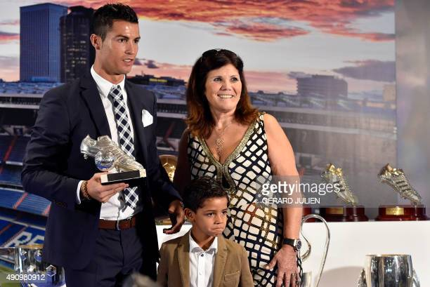 Real Madrid's forward Portuguese Cristiano Ronaldo poses with his son Cristiano Jr and his mother Maria Dolores dos Santos Aveiro during a ceremony...