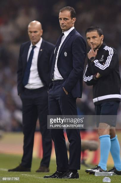 Real Madrid's French coach Zinedine Zidane and Juventus' manager Massimiliano Allegri look on during the UEFA Champions League final football match...