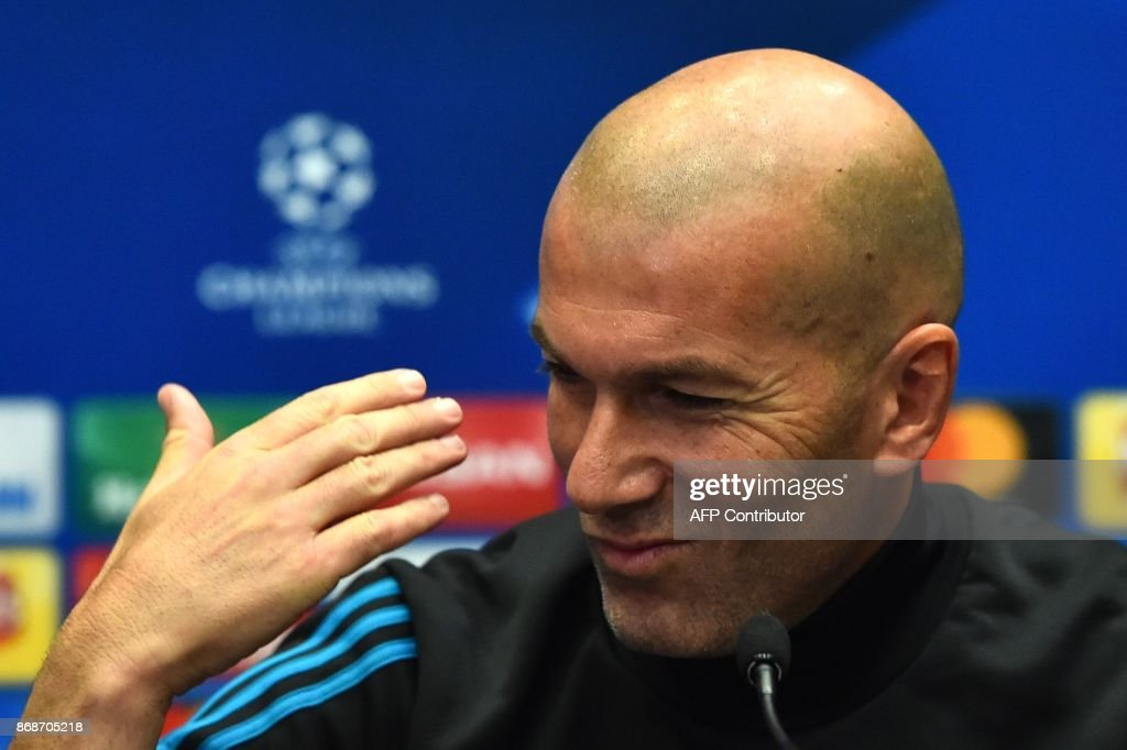Real Madrid's French coach Zinedine Zidane attends a press conference at Wembley Stadium, in north London, on October 31, 2017 on the eve of their UEFA Champions League group H football match against Tottenham Hotspur. / AFP PHOTO / Glyn KIRK