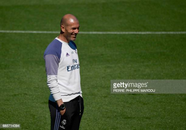 Real Madrid's French coach Zinedine Zidane attends a training session at Valdebebas Sport City in Madrid on May 20 2017 on the eve of their last Liga...