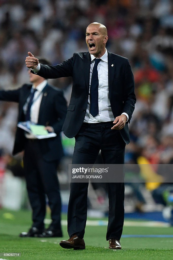 Real Madrid's French coach Zinedine Zidane gestures on the sideline during the UEFA Champions League semi-final second leg football match Real Madrid CF vs Manchester City FC at the Santiago Bernabeu stadium in Madrid, on May 4, 2016. / AFP / JAVIER