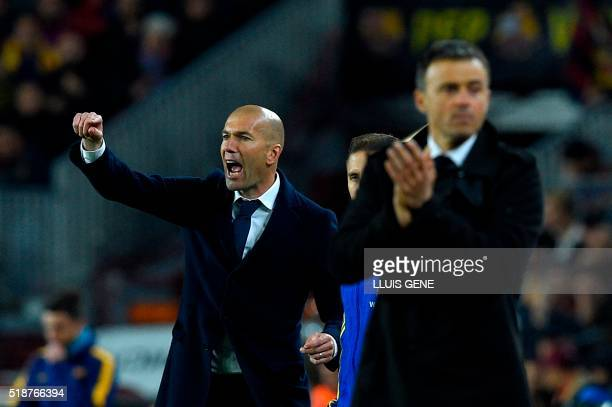 Real Madrid's French coach Zinedine Zidane gives instructions to players during the Spanish league 'Clasico' football match FC Barcelona vs Real...