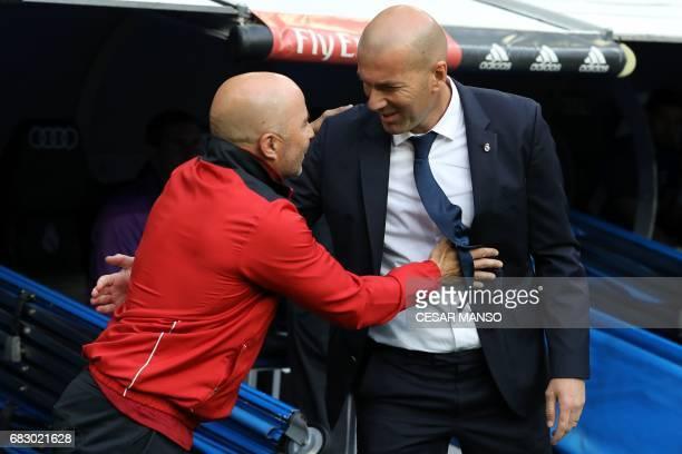 Real Madrid's French coach Zinedine Zidane greets Sevilla's Argentinian coach Jorge Sampaoli before the Spanish league football match Real Madrid CF...
