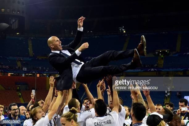 TOPSHOT Real Madrid's French coach Zinedine Zidane is lifted by his players after Real Madrid won the UEFA Champions League final football match...