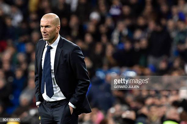 TOPSHOT Real Madrid's French coach Zinedine Zidane looks at players during the Spanish league football match Real Madrid CF vs RC Deportivo La Coruna...
