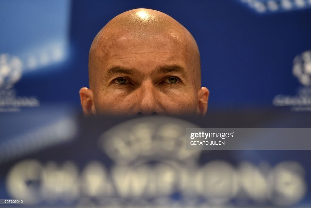 Real Madrid's French coach Zinedine Zidane looks on during a press conference at Valdebebas training ground in Madrid on May 3, 2016, on the eve of the UEFA Champions League semi-final second leg football match between Real Madrid CF and Manchester City. / AFP / GERARD