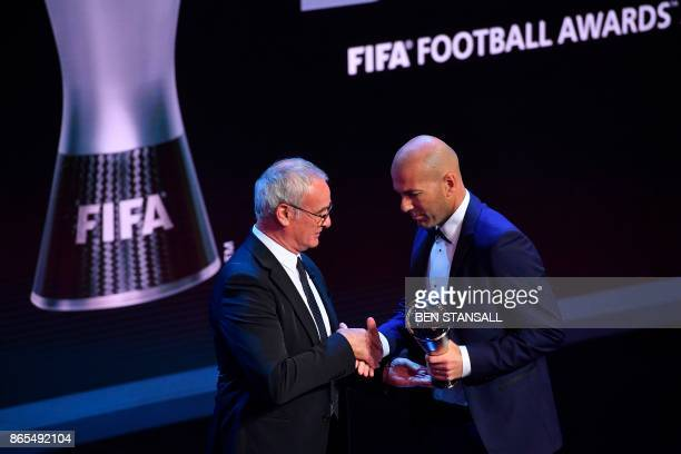 Real Madrid's French coach Zinedine Zidane shakes hands with Italian manager of Nantes Claudio Ranieri after winning The Best FIFA Men's Coach of...