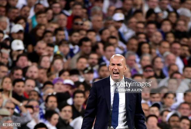 TOPSHOT Real Madrid's French coach Zinedine Zidane shouts on the sideline during the Spanish league Clasico football match Real Madrid CF vs FC...