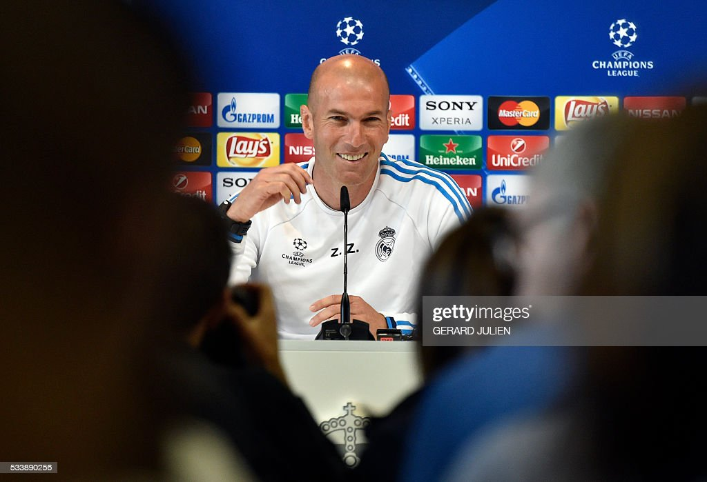 Real Madrid's French coach Zinedine Zidane smiles as he addresses journalists during a press conference on the club's Open Media Day at Real Madrid sport city in Madrid on May 24, 2016. / AFP / GERARD