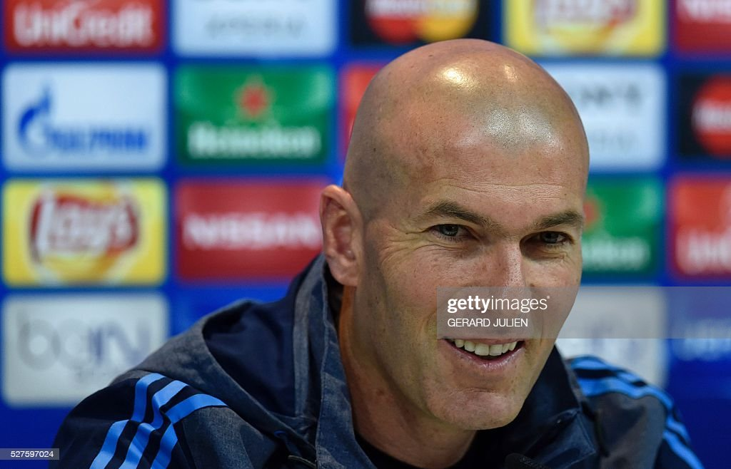 Real Madrid's French coach Zinedine Zidane smiles during a press conference at Valdebebas training ground in Madrid on May 3, 2016, on the eve of the UEFA Champions League semi-final second leg football match between Real Madrid CF and Manchester City. / AFP / GERARD