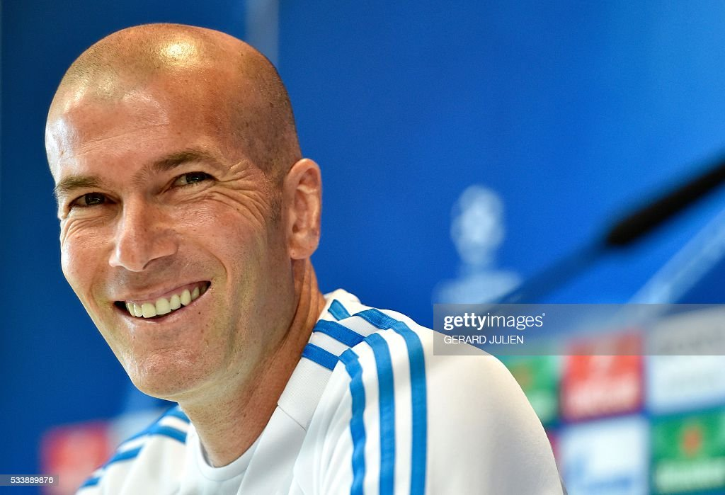 Real Madrid's French coach Zinedine Zidane smiles during a press conference at the club's Open Media Day at Real Madrid sport city in Madrid on May 24, 2016. / AFP / GERARD