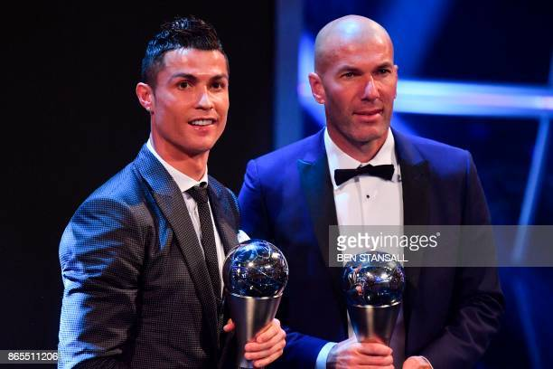 TOPSHOT Real Madrid's French coach Zinedine Zidane stands with his trophy for winning The Best FIFA Men's Coach of 2017 Award alongside Real Madrid...