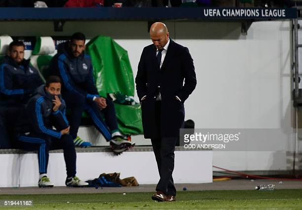 Real Madrid's French coach Zinedine Zidane walks along the sidelines during the UEFA Champions League quarterfinal firstleg football match between...