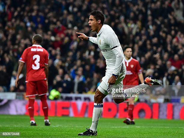Real Madrid's French defender Raphael Varane celebrates after scoring during the Spanish Copa del Rey round of 16 first leg football match Real...
