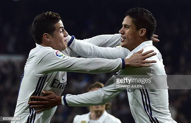 Real Madrid's French defender Raphael Varane celebrates with Real Madrid's Colombian midfielder James Rodriguez after scoring during the Spanish Copa...