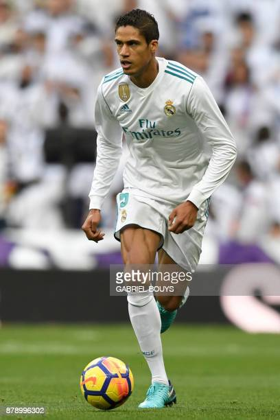 Real Madrid's French defender Raphael Varane controls the ball during the Spanish league football match Real Madrid CF against Malaga CF on 25...