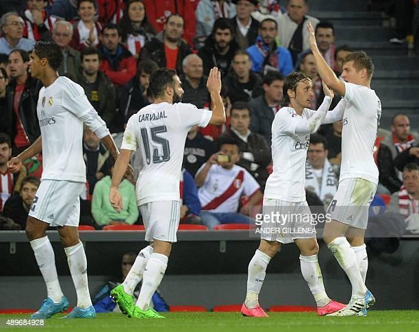 Real Madrid's French defender Raphael Varane defender Daniel Carvajal Croatian midfielder Luka Modric and German midfielder Toni Kroos celebrate...