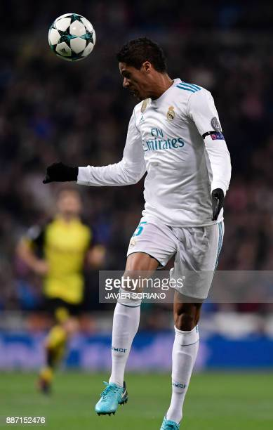 Real Madrid's French defender Raphael Varane heads the ball during the UEFA Champions League group H football match Real Madrid CF vs Borussia...