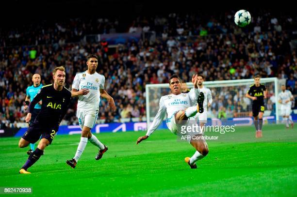 Real Madrid's French defender Raphael Varane kicks the ball during the UEFA Champions League group H football match Real Madrid CF vs Tottenham...
