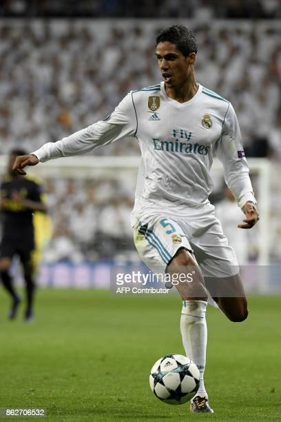 Real Madrid's French defender Raphael Varane runs with the ball during the UEFA Champions League group H football match Real Madrid CF vs Tottenham...