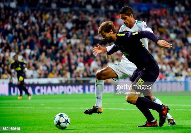 Real Madrid's French defender Raphael Varane vies for the ball with Tottenham Hotspur's Spanish striker Fernando Llorente during the UEFA Champions...