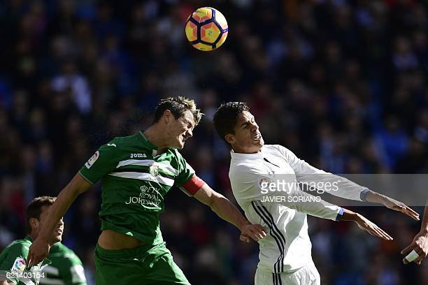 TOPSHOT Real Madrid's French defender Raphael Varane vies with Leganes's defender Bustinza during the Spanish league football match Real Madrid CF vs...