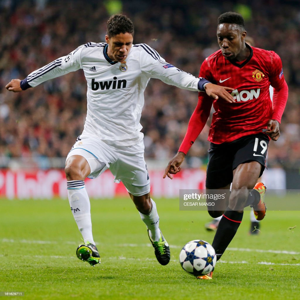 Real Madrid's French defender Raphael Varane (L) vies with Manchester United's striker Danny Welbeck during the UEFA Champions League round of 16 first leg football match Real Madrid CF vs Manchester United FC at the Santiago Bernabeu stadium in Madrid on February 13, 2013.