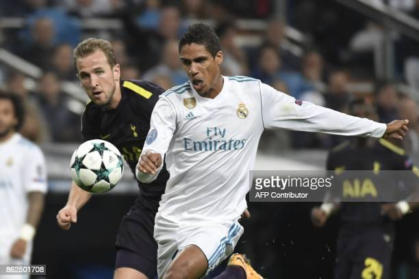Real Madrid's French defender Raphael Varane vies with Tottenham Hotspur's English striker Harry Kane during the UEFA Champions League group H...